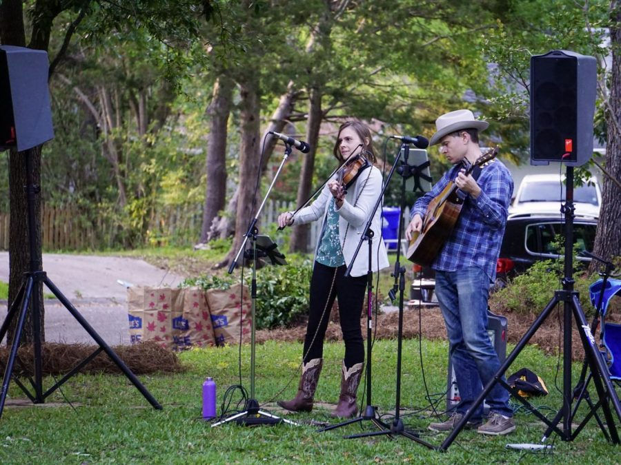 The front yard of Derek and Lisa Deakins was filled with PA speakers, microphones, and music on April 17.