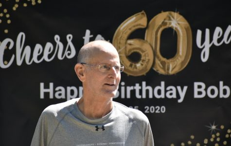 In honor of Wando athletic director Bob Hayes' 60th birthday, Coach Glover organized for friends, family, Wando alum, and students to drive past Hayes' house with signs to wish him a happy birthday.