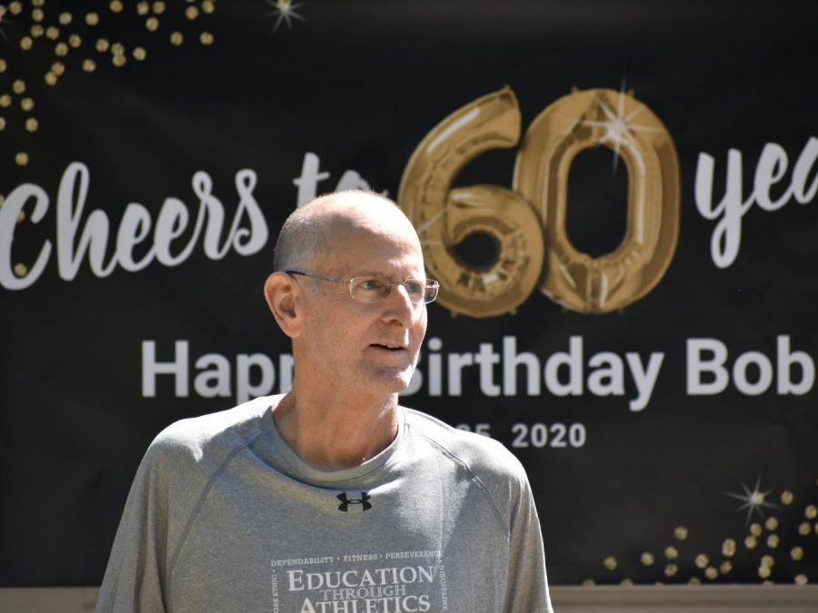 In honor of Wando athletic director Bob Hayes 60th birthday, Coach Glover organized for friends, family, Wando alum, and students to drive past Hayes house with signs to wish him a happy birthday.