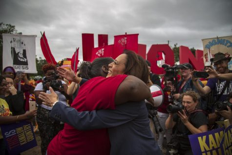 Presidential candidate Kamala Harris hugs Fight for $15 marcher Taiwan Milligan