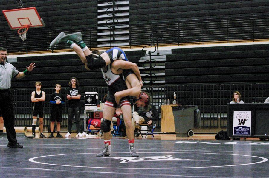 Senior Cooper Rhue picks up his Cane Bay opponent on Jan 23 before slamming him onto the mat.