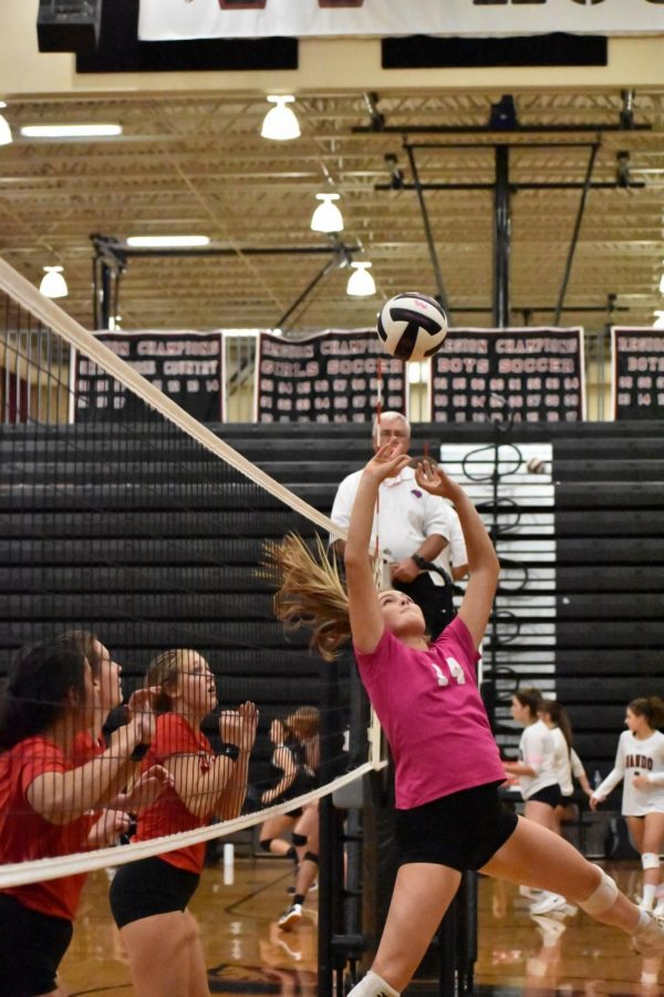 Junior Ava McCarthy assists the volleyball to another teammate in the Varsity Volleyball game against Stratford on October 8 when the Warriors landed a win.