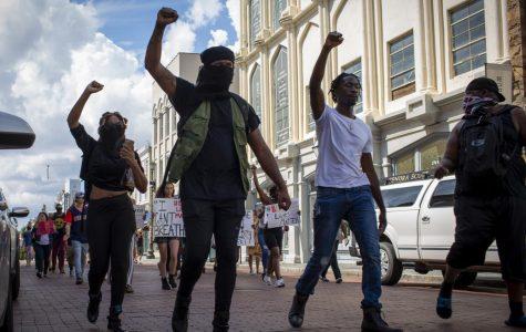 Black Lives Matter Protestors marching down King Street.