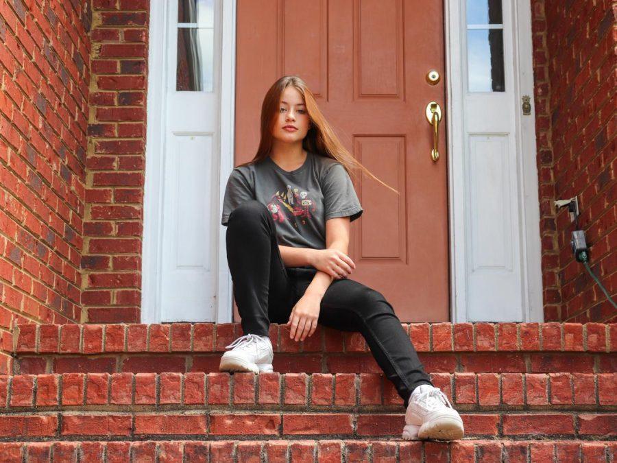 Maddie Apostolis sits on her porch.