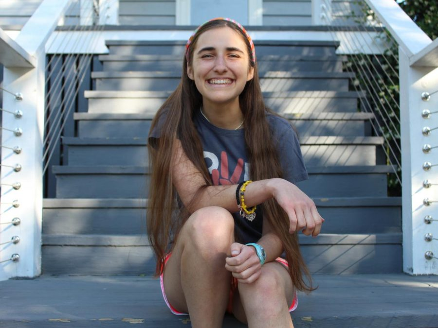 Molly Kerr sits on her porch.