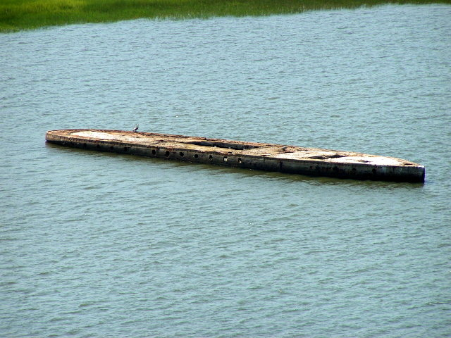 The old sunken hull as seen from the Ravenel Bridge.