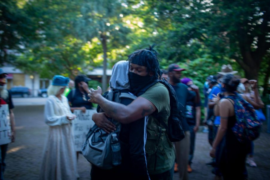 BLM Protester Halo Alkemis-Ptah Quaponda hugging other protester. Another group had dressed up in antebellum clothing with whips and makeup lash marks in an attempt to help the protest but ended up being asked to leave immediately by protest leaders.