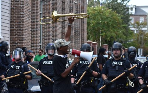 Through the use of emotional speeches, Marcus McDonald captured the importance of why he protests and why change is needed. He raises his trumpet as a sign that he will not be silenced.