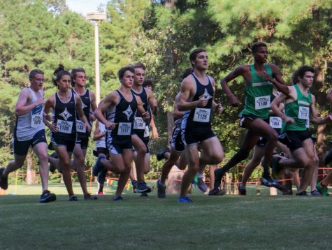 Boys Varsity Cross Country blast off from the starting line, ready to place 1st at the Warrior XC invitational.