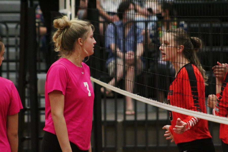 Junior Emily Sturdivant faces off against player on opposing team through the net after Stratford got scored on.