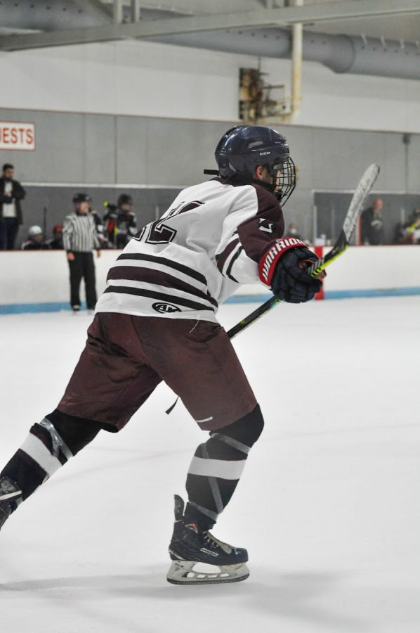 Sophomore Tristan Cotton skates out of the zone after clearing the puck