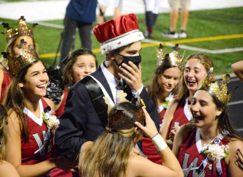Wando cheeerleaders surround Senior Charlie Rohaley before lifting him into the air.