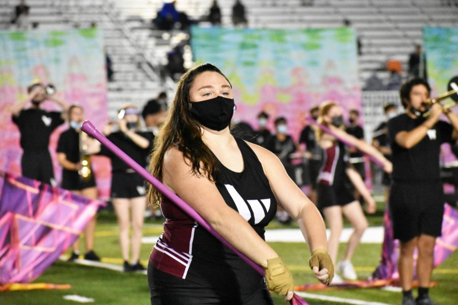 Sophomore Ryleigh Champion performs with the Wando color guard during halftime at the homecoming game on October 23.