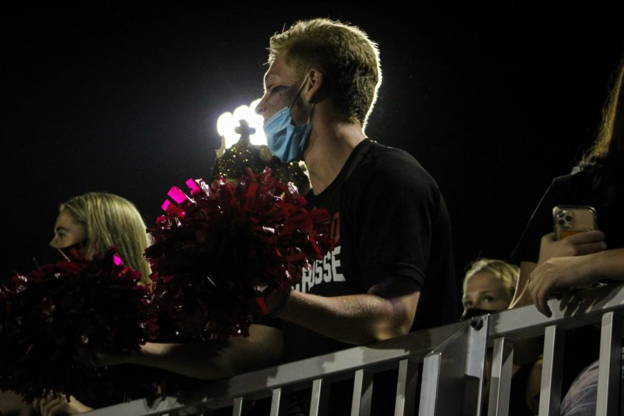 Senior Brian Leonard leads the Chophouse during Wando's homecoming football game.