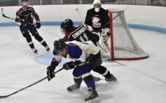 Junior, Drew Edmonds shoved a Fusion player out of the way to get the puck