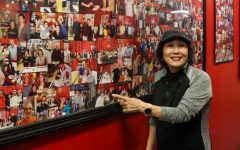 Brown points to a wall of photos in the restaurant containing images of different customers that have passed through over the years.