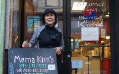 Mama Kim stands in front of her restaurant