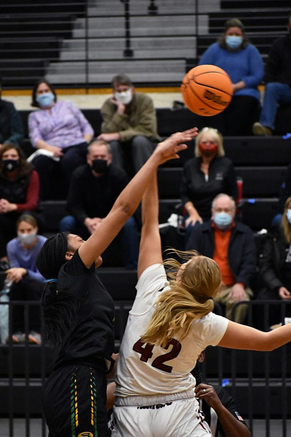 Senior Miriam Berle tips off the ball to start the game against Summerville on Dec 1.