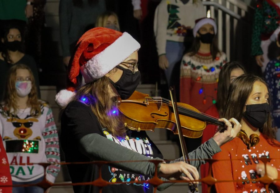 Senior Kate Stribling accompanies the Wando Chorus in many of their Christmas songs at the Sullivan's Annual Tree Lighting.