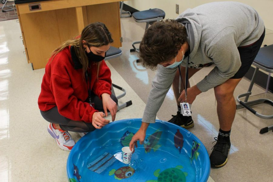 Juniors Parker Klein and Illyanna Lightfoot work together to contain the oil in the water.