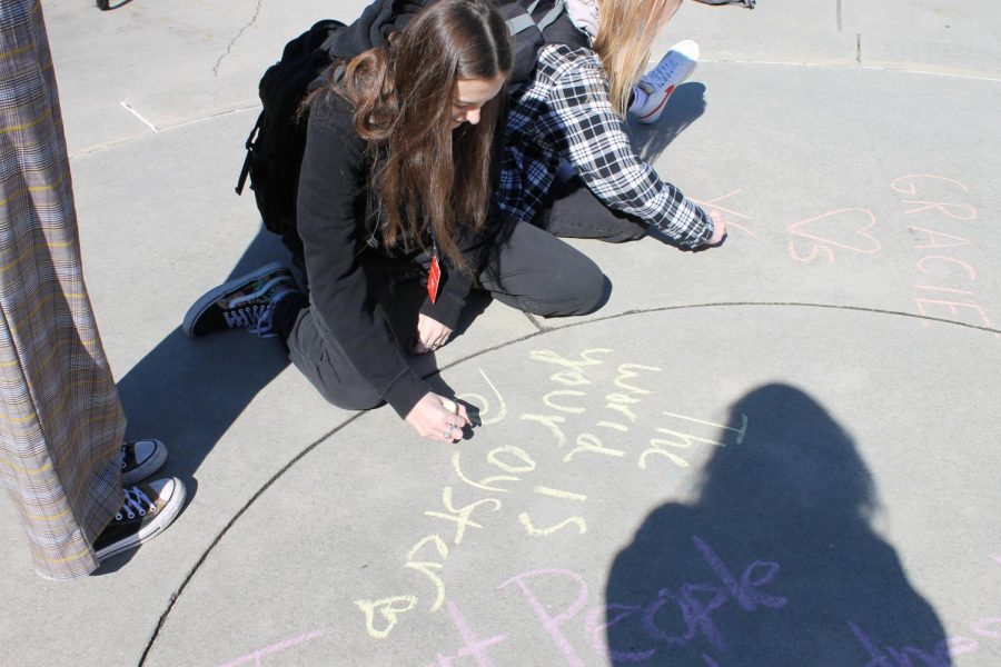 Gracie Bodine (11) and Ann Frances Allison (12) drawing with chalk during wellness week.