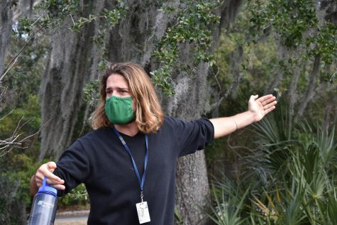 Teacher Joshua Driscoll explains aspects of nature around Wando to students.
