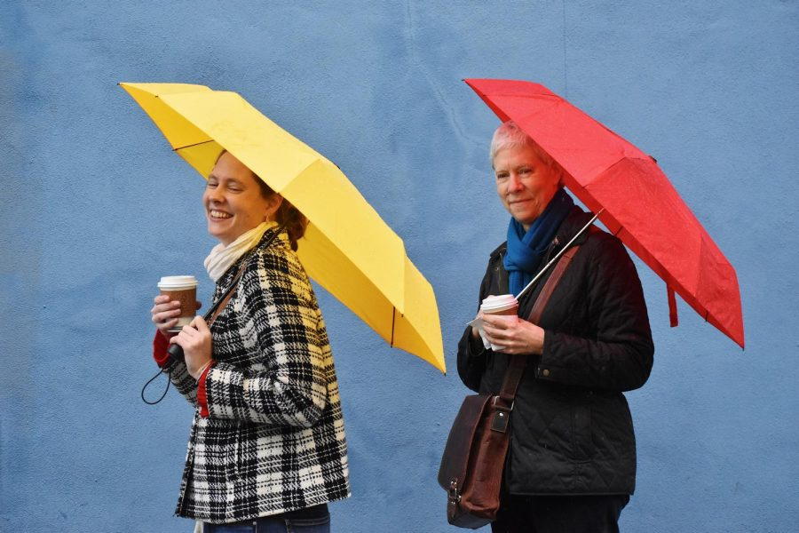 """Molly Jenson (left) says, """"I love holding onto a colorful umbrella on gloomy days. It al- ways just adds a pop of color on a dreary day and helps me stay in a good mood."""""""