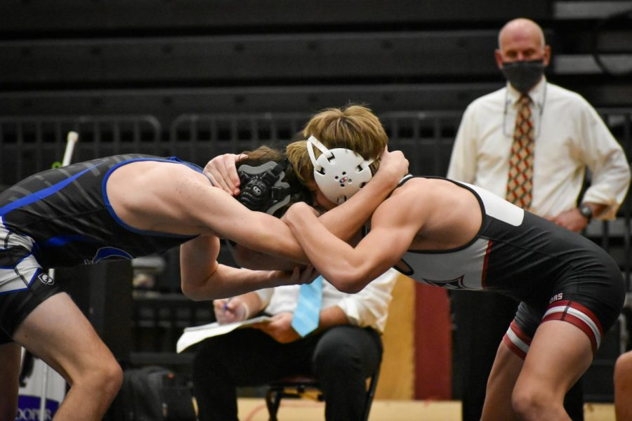 Sophomore Dom Polesovsky interlocks with his opponent at the beginning of the match.