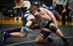 Junior Jacob Pelbath flips his opponent to the ground.