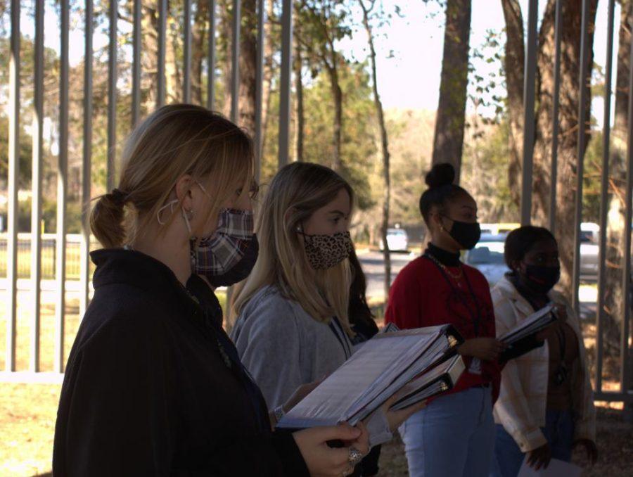 Senior+Cameron+Cradock+practicing+outside+for+show+choir.%0A
