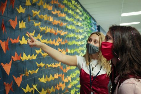 Juniors Alli Ryan and Bailey Young admire the artwork of Bratcher's students during their lunch period.