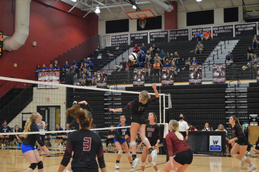 Sophmore Bridey Potter playing her position as middle blocker on the Wando varsity volleyball team.