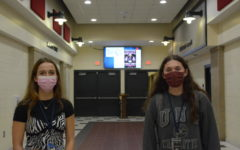 Juniors Ava Shoonerover (right) and Leia Eilsen (left) demonstrate Wandos new mask requirement in the building.