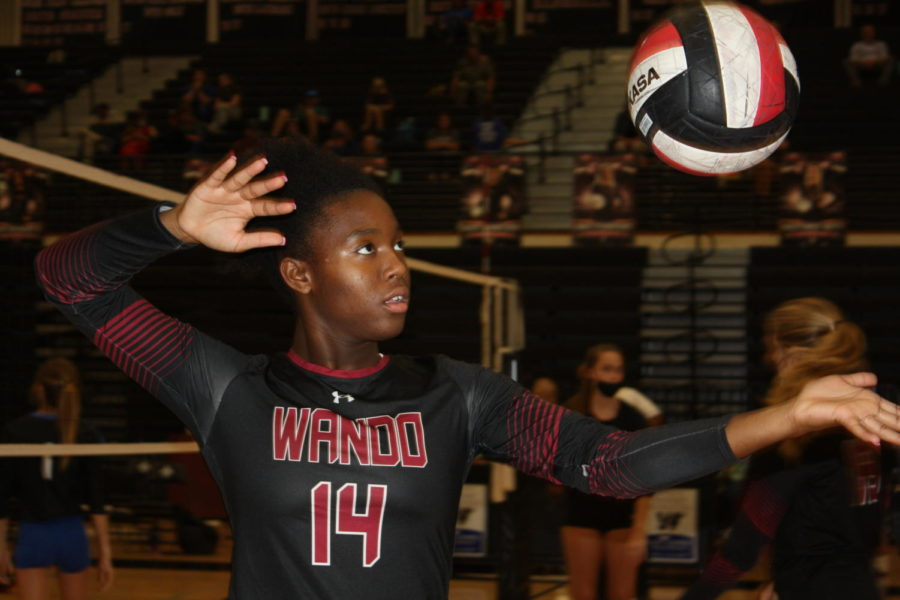 Junior Aurie Fisher stands posed ready to spike the ball versus Cane Bay.