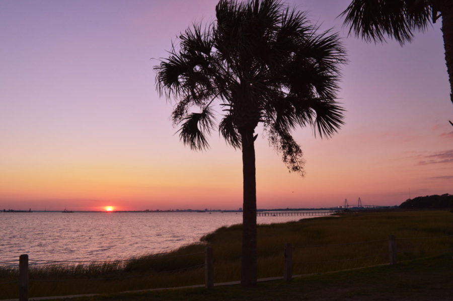 The view of one of Charlestons one of a kind sunsets seen at the Pitt Street bridge here in Mount Pleasant, featuring Charlestons famous Ravenel Bridge in the back!